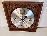 "Mid Century Modern Cork and Wood Wall ClockWelby battery operated clockin good condition with minor wear and scratches but overall nice conditionMeasures 12.5"" x 12.5""Thank You"