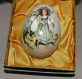 Easter 1978 Royal Bayreuth Germany Porcelain egg in the original box. The design is a Victorian girl surrounded by little yellow chicks. The egg is approximately 3 X 2 1/4 and it is in perfect condition. The box shows a little wear. Please write me if you