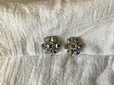 Pair of floral design round faceted prong set iridescence rhinestones clip on earrings
