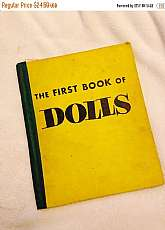 The First Book of Dolls, by Helen Hoke, Franklin Watts, Inc., New York, 1954. Hardcover.  Jean Michener (illustrator). Stated Fifth Printing. Yellow cloth over board with title stamped on cover in black. Color illustrated end papers. Pages clean and brigh