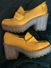 Brushed yellow leather loafers with sparkling rubber platform heels.