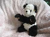Vintage Steiff Molly Panda plush is in good vintage condition with light wear. This is a large Steiff plush which is teddy bear sized. It is not made of mohair and is softer and cuddlier. Please view our other items. Multiple item purchases receive a comb