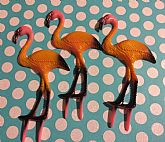 Kitschy plastic flamingo for garden or cake.