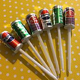 Miniature unused soda cans on plastic picks.