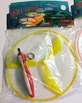 Fun flying saucer toy in original package.