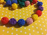 Fun retro monster pop beads that look like Madballs.