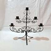 This is a gorgeous Vintage black iron candle holder/candelabra that holds 5 taper sized candles.It is a cut-out scrolly design, reminiscent of the Spanish Mediterranean style of the 1950's and 60's. It looks as though it should be in Dracula's castle!T