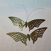 This is a matching set of solid brass butterfly wall hangings.They were made in India and date to the 1970's.Each measures 14 1/2 inches across.There is a loop on the back to hang on the wall.They are in excellent condition with a natural age and oxid